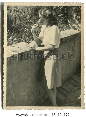 Vintage photo of young woman, forties - stock photo