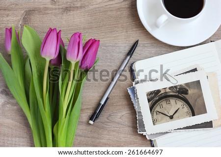 vintage photo retro style flowers tulips gift wood background - stock photo