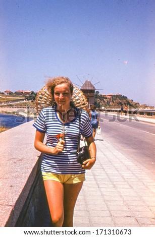 Vintage photo (scanned reversal film) of young girl in Nesebar, Bulgaria (1972) - stock photo