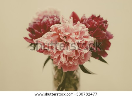 Vintage photo with grain of the pink dahlia in vase - stock photo