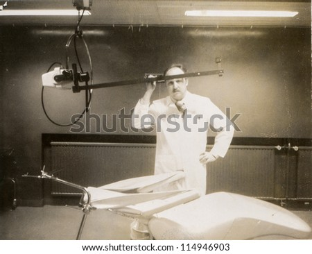 Vintage photo young doctor in hospital (early seventies) - stock photo