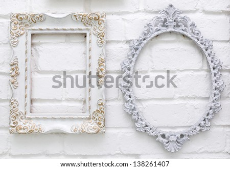 Vintage picture frames on white brick wall background - stock photo