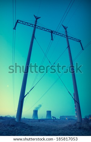 Vintage picture. Sunset over the nuclear power plant - stock photo