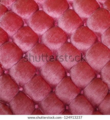 Vintage pink button tufted velvet background texture. - stock photo