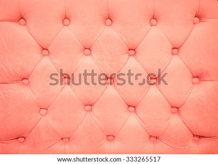 Vintage pink leather upholstery buttoned sofa (background) - stock photo