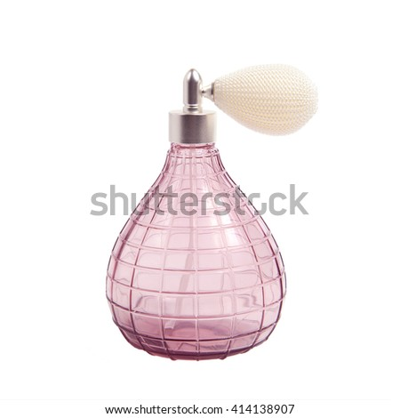 Vintage pink perfume spray bottle with pump isolated on white background - stock photo