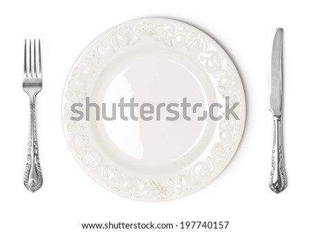 Vintage plate, knife and fork on white background - stock photo