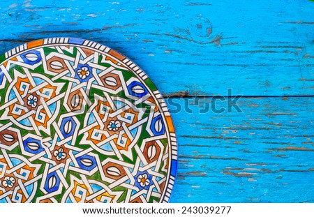 Vintage Plate on wooden background in blue color - stock photo