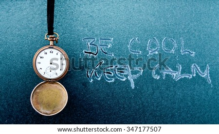 Vintage pocket clock and text on frost car window - stock photo