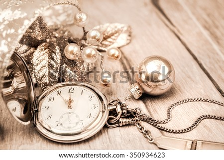 Vintage pocket clock showing five to twelve. Happy New Year! This image is toned. Shallow DOF, focus on the number 12 and ends of the clock hands - stock photo