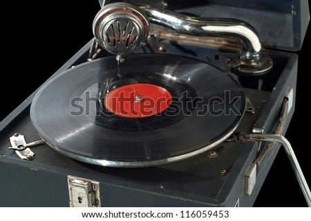 Vintage portable record player.  Isolated on black - stock photo
