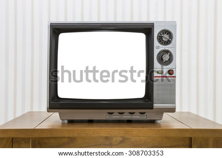 Vintage portable television on old craftsman style table with cut out screen and clipping path. - stock photo