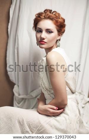 Vintage portrait of a beautiful queen like girl in bedroom. retro style. studio shot - stock photo