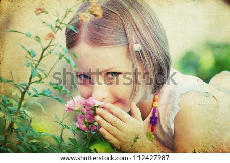 Vintage portrait of a cute little girl smelling a flower - stock photo
