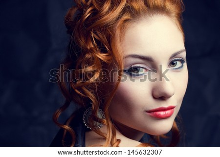Vintage portrait of a glamorous queen like red-haired (ginger) girl posing over wrinkled black paper background. Retro style. Close up. Copy-space. Studio shot - stock photo