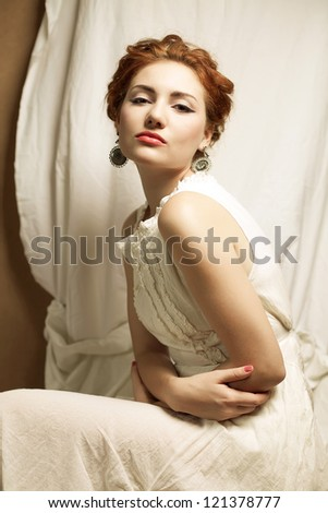 Vintage portrait of a glamourous queen like girl in bedroom. Retro style. Studio shot - stock photo
