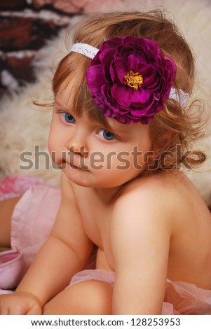vintage portrait of adorable baby girl with purple flower on hair band - stock photo