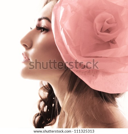 Vintage portrait of fashion glamour girl with red flower in her hair. Studio shot - stock photo