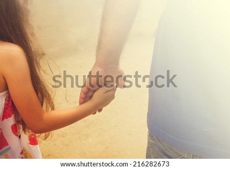 Vintage portrait of Father and daughter holding hand in hand in summer day - stock photo