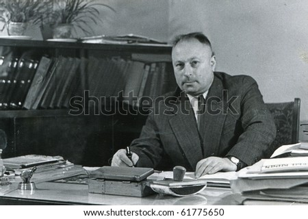 Vintage portrait of man in his office (fifties) - stock photo