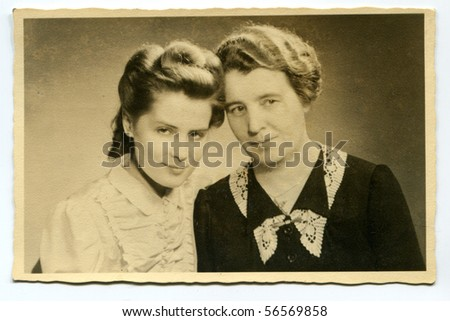 Vintage portrait of mother and daughter (twenties) - stock photo
