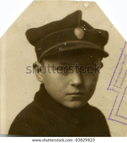 Vintage portrait of schoolboy in uniform (twenties) - stock photo