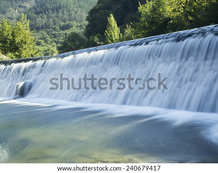 vintage postal of a dam, retro renewable energy - stock photo