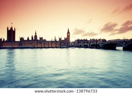 Vintage postcard of Parliament with Big Ben at dusk - stock photo