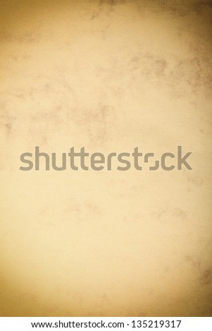 Vintage poster paper texture with a glowing center and grunge vignette abstract background - stock photo