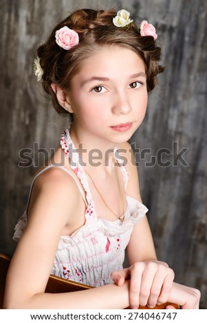 Vintage potrait of a beautiful girl with braided hair wearing summer sundress. Children fashion. Retro style. - stock photo