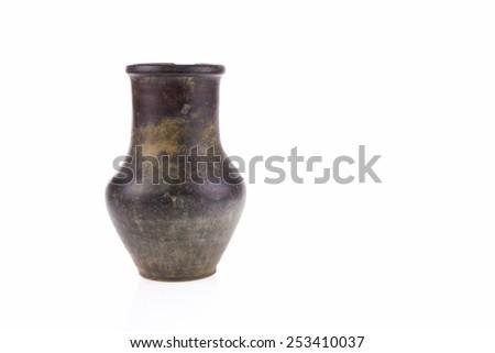 Vintage pottery on white background - stock photo