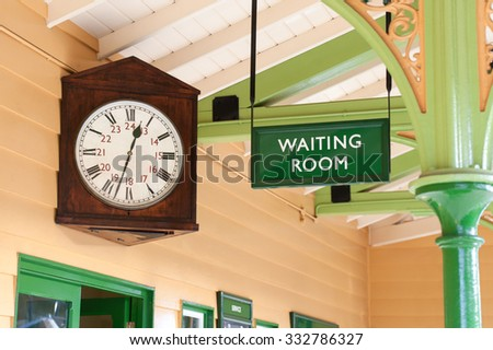 vintage public amenity waiting room and large antique clock - stock photo