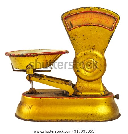 Vintage puppet house model of a weighing scale isolated on a white background - stock photo