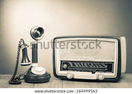 Vintage radio and telephone on table old style photo - stock photo