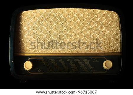 Vintage radio on black background - stock photo