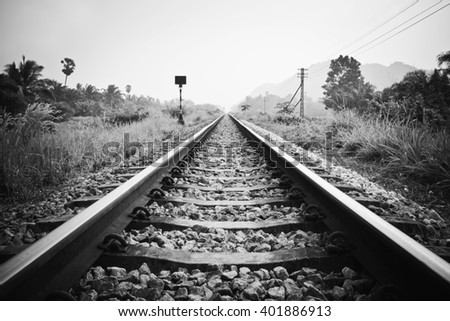 vintage railroad with black and white effect - stock photo