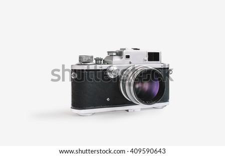 Vintage rangefinder film camera on white isolated background - stock photo