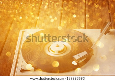 vintage record player and glitter lights - stock photo