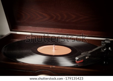 Vintage record player with vinyl record selective focus - stock photo