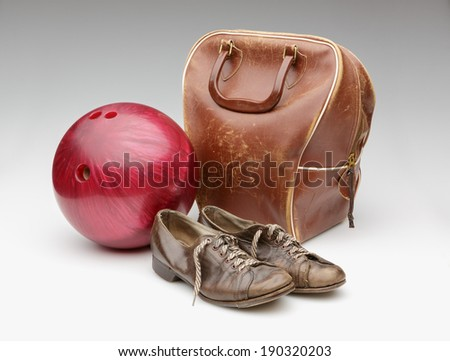 Vintage Red Bowling Ball, Weathered Leather Bag and Brown Shoes Isolated on White - stock photo
