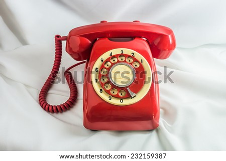 Vintage red phone on white background. - stock photo