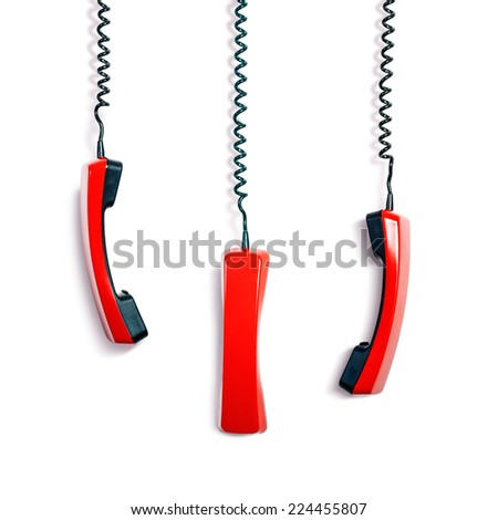 Vintage red phone receivers collection on white background. Communication technology - stock photo