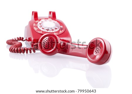 Vintage red rotary phone (with clipping path).A 1950-s Western Electric 500 model rotary telephone isolated on white. - stock photo