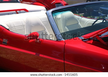 Vintage Red Sports Car with White Leather Interior - stock photo