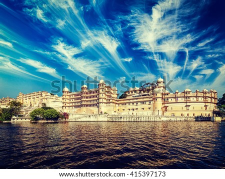 Vintage retro effect filtered hipster style image of City Palace view from the lake. Udaipur, Rajasthan, India - stock photo