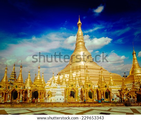 Vintage retro effect filtered hipster style image of Myanmer famous sacred place and tourist attraction landmark - Shwedagon Paya pagoda. Yangon, Myanmar - stock photo