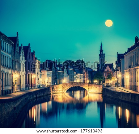 Vintage retro hipster style travel image of European medieval night city view background - Bruges (Brugge) canal in the evening, Belgium - stock photo