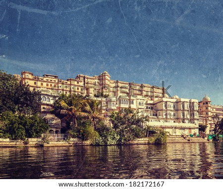 Vintage retro hipster style travel image of India luxury tourism concept background - Udaipur City Palace from Lake Pichola with grunge texture overlaid. Udaipur, Rajasthan, India - stock photo
