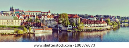 Vintage retro hipster style travel image of panorama of historic center of Prague:  Gradchany (Prague Castle) and St. Vitus Cathedral in the morning - stock photo