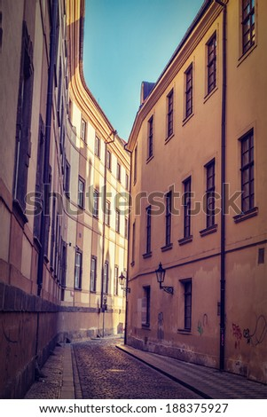 Vintage retro hipster style travel image of Prague street with old houses, Prague, Czech Republic - stock photo